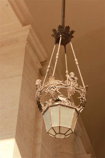 I love lighting fixtures, and I especially fancied this one. They were strung within the halls of the buildings surrounding St. Peter's square.