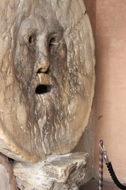 "Translated as ""The Mouth of Truth"". The Bocca Della Verita' has even been the movies. Perhaps you have seen Roman Holiday? While we waited for Robert, we watched tourist after tourist walk up to it and take a picture with their hand in its mouth."
