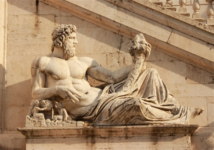 """This statue is called the """"Tiber"""", and represents the Tiber river. It is located on the right side of the Palazzo Senatorio. Both of these statues were created during the same time and were originally found in the ruins of the Baths of Constantine."""