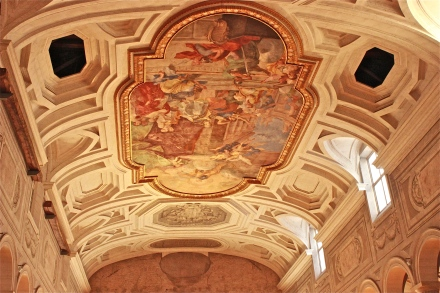 This ornate ceiling's center focal point is this 18th century Miracle in Chain fresco by Giovanni Battista Parodi.