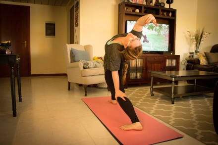This is what my home practice looks like! In this picture I am doing a video from one of my favorites, Yoga with Adrienne.